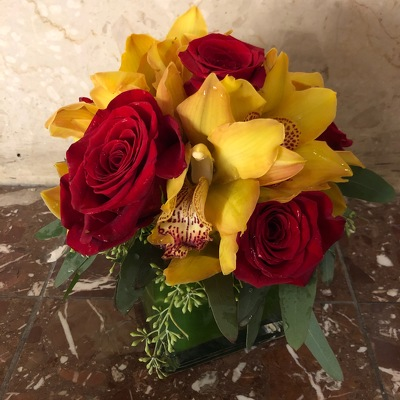 Red and Yellow Orchid Cube from Mangel Florist, flower shop at the Drake Hotel Chicago