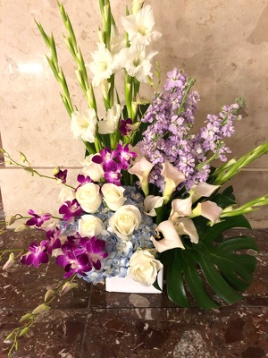 Soft Purple and Blue Sympathy Spray from Mangel Florist, flower shop at the Drake Hotel Chicago