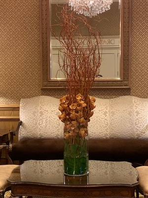 Tall Willow and Orchid Arrangement from Mangel Florist, flower shop at the Drake Hotel Chicago