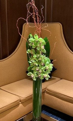 Tall Slim Branch and Orchid Arrangement  from Mangel Florist, flower shop at the Drake Hotel Chicago