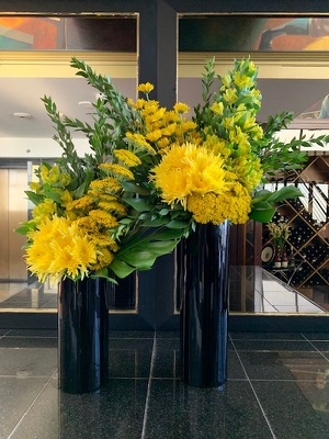Tall Yellow Arrangmenets from Mangel Florist, flower shop at the Drake Hotel Chicago