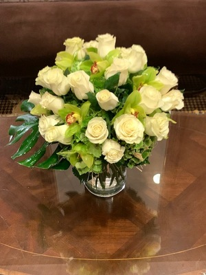 White Roses with Green Cymbidium Orchids from Mangel Florist, flower shop at the Drake Hotel Chicago